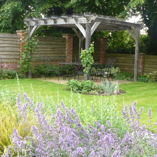 Modern Cottage Garden Oak-timber arbour with seating